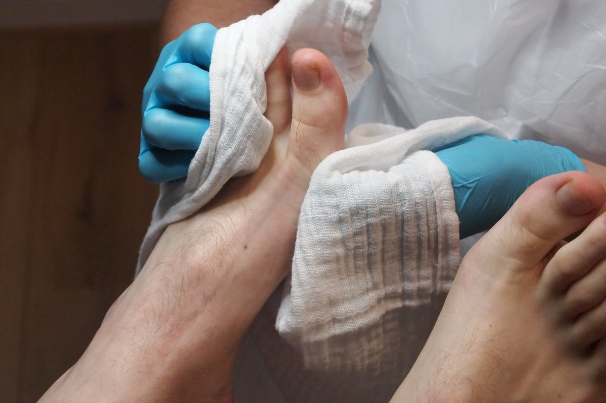 Drying off feet for proper foot care