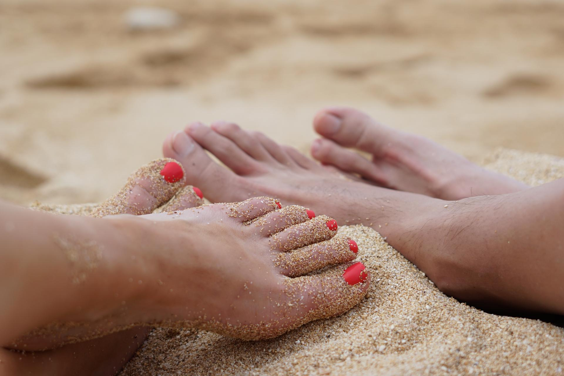 Man and woman's feet in the sand