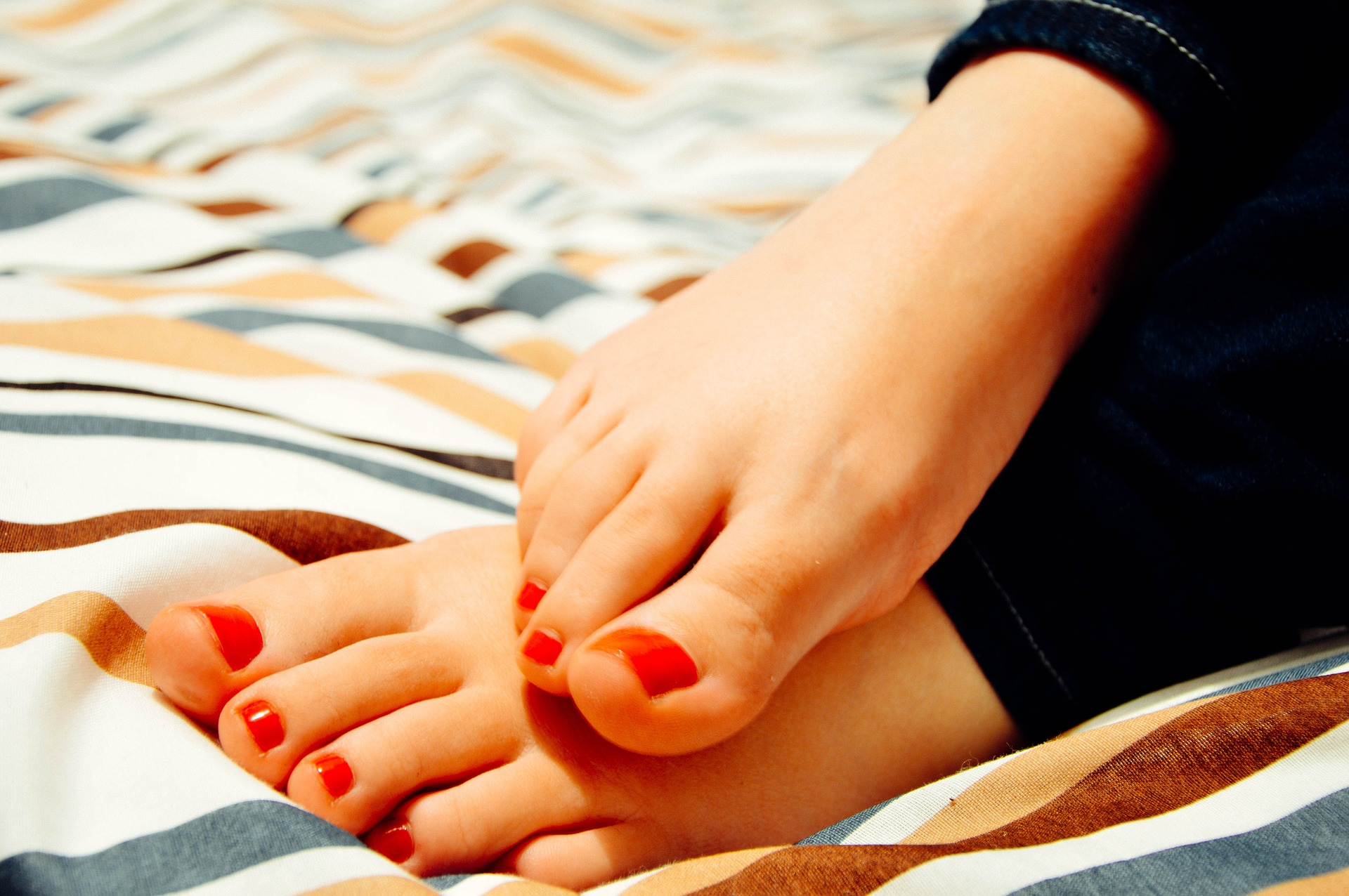 Woman's feet with polished toes